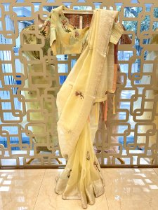 Soft lime toned zari bordered organza saree