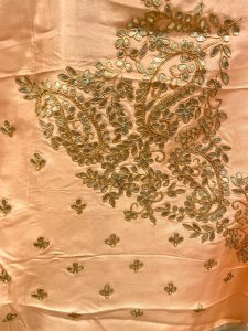 Aquamarine and pastel pink paneled pure organza saree